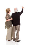 Senior couple pointing Royalty Free Stock Photo