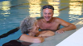 Senior couple in pool stock video