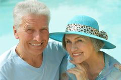 Senior couple by pool Stock Photo