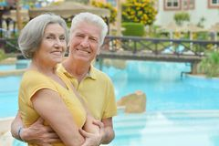 Senior couple by pool at the resort Stock Photography