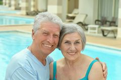 Senior couple by pool Royalty Free Stock Photos