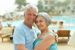 Senior couple by pool Royalty Free Stock Photography