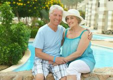 Senior couple by pool Stock Photography