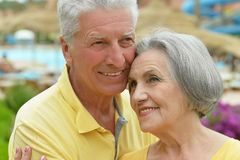 Senior couple by pool Royalty Free Stock Photo