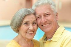 Senior couple by pool Royalty Free Stock Image