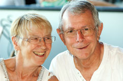 Senior couple portrait. Attractive senior couple, happy together, both wearing glasses Stock Photography