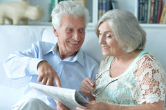 Senior couple portrait with newspaper Royalty Free Stock Photo