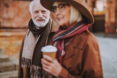 Stylish old man spending time with lovely lady outdoors royalty free stock photo