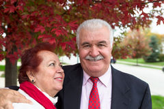 Senior Couple Portrait Under the Autumn Tree Royalty Free Stock Photos