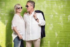 Senior couple posing together. Fashionable beautiful senior couple posing together , wearing sunglasses Royalty Free Stock Image