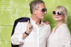 Senior couple posing together. Fashionable beautiful senior couple posing together , wearing sunglasses Stock Photo