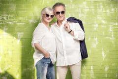 Senior couple posing together. Fashionable beautiful senior couple posing together , wearing sunglasses Royalty Free Stock Photo