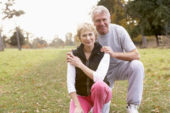 Senior Couple Power Jogging In The Park royalty free stock photography