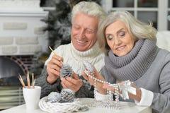Senior couple preparing for Christmas Royalty Free Stock Photo
