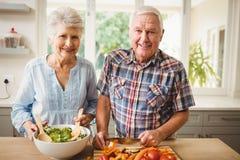 Senior couple preparing salad Stock Photography