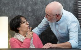 Senior couple with problems at home, woman angry royalty free stock photos
