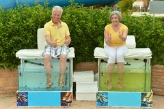 Senior couple on procedure for foot care Royalty Free Stock Images