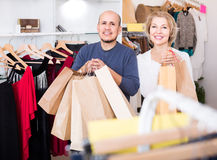 Senior couple with purchases in bags at apparel store. Happy european senior couple with purchases in bags at apparel store Royalty Free Stock Photography