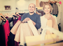 Senior couple with purchases in bags at apparel store. Happy european senior couple with purchases in bags at apparel store Royalty Free Stock Photos