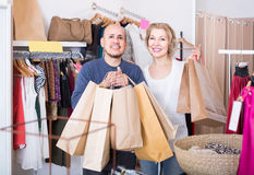 Senior couple with purchases in bags at apparel store Stock Photo