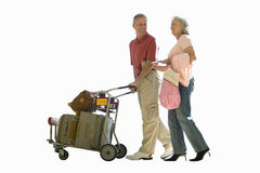 senior couple pushing luggage, cut out Royalty Free Stock Photo