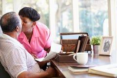 Free Senior Couple Putting Letter Into Keepsake Box Royalty Free Stock Image - 39232896