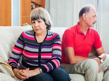 Senior couple after quarrel. In living room Stock Image
