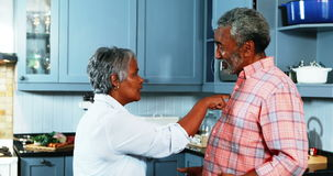 Senior couple quarrelling with each other in kitchen stock footage