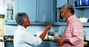 Senior couple quarrelling with each other in kitchen stock video