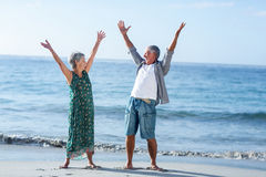 Senior couple raising arms Royalty Free Stock Photography