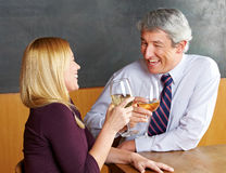 Senior couple raising glasses for Stock Image