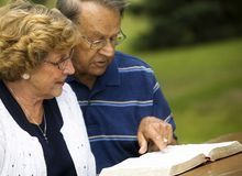 Senior Couple Reading The Bible Royalty Free Stock Photos