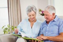 Senior couple reading a book Stock Image