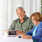 Senior couple reading books Stock Photos
