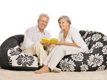 Senior couple reading Stock Images