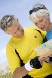 Senior Couple Reading Map Royalty Free Stock Photos