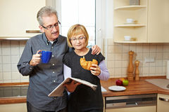 Senior couple reading newspaper Stock Photo