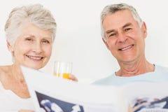 Senior couple reading newspaper Stock Photography