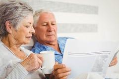 Senior couple reading newspaper Royalty Free Stock Photo