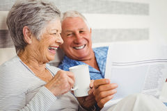 Senior couple reading newspaper Stock Images