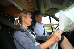 Senior couple reading the road map in camping car travelling Stock Photo