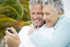 A senior couple reading a text message Stock Images