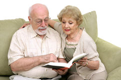 Senior Couple Reading Together Royalty Free Stock Images