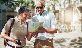 Senior couple reading a tourist map Stock Images