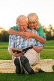 Senior couple reads book. Royalty Free Stock Image