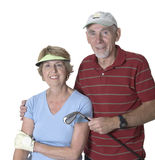 Senior couple ready for golf. Studio shot of  active senior man and woman golfing partners. White background Stock Images