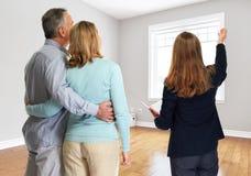 Senior couple with realtor. Realtor broker women showing new house senior couple Royalty Free Stock Image