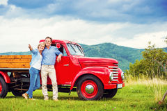 Senior couple with red car Royalty Free Stock Image