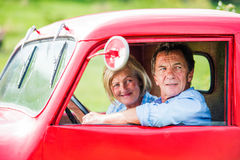 Senior couple in red car Stock Photo