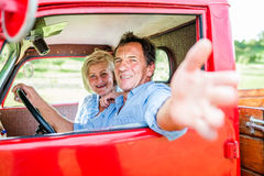 Senior couple in red car Royalty Free Stock Photos